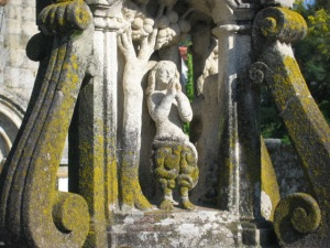 Adam following his expulsion from Paradise, as represented on the base of the Cruceiro de Hío.