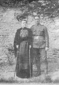Photo of Forrest Beauchamp – Forrest Beauchamp and his mother (circa June 1916) taken at Foxleigh, Saskatchewan. Copyright/source: http://www.veterans.gc.ca